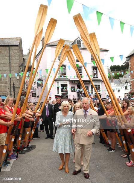 Prince Charles Prince Of Wales puts his fingers in his ears as a small cannon is fired to begin the Gig Club race at the Fowey Festival Celebration...