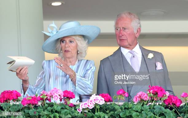 Camilla, Duchess of Cornwall and Prince Charles, Prince of Wales watch racing from the Royal Box during Royal Ascot 2021 at Ascot Racecourse on June...