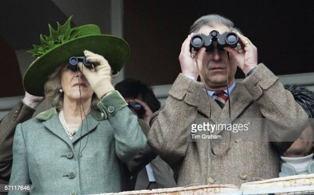 Camilla Duchess of Cornwall and Prince Charles Prince of Wales watch the Gold Cup race on the final day of Cheltenham Races on March 17 2006 in...
