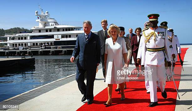 Camilla Duchess of Cornwall and Prince Charles The Prince of Wales walk down the red carpet from the Royal Yacht 'Leander' as they arrive at Staubles...