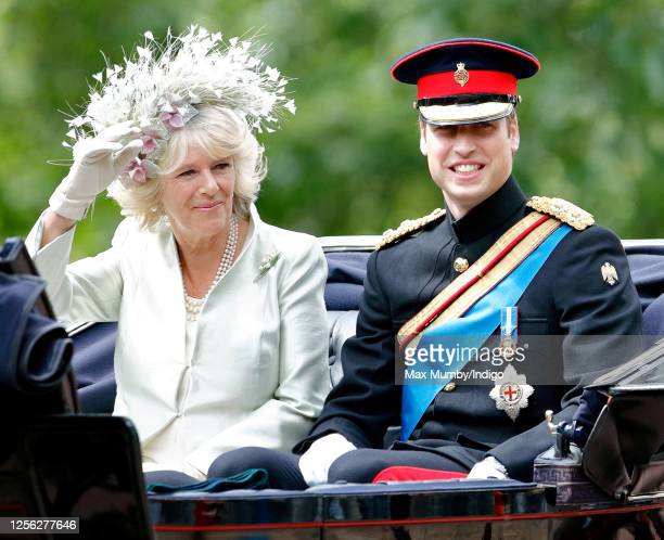 Camilla, Duchess of Cornwall and Prince William travel down The Mall in a horse drawn carriage during the annual Trooping the Colour Parade on June...