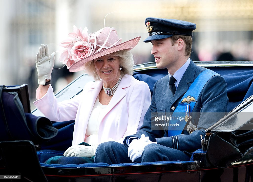 Camilla, Duchess of Cornwall and Prince William, wearing his