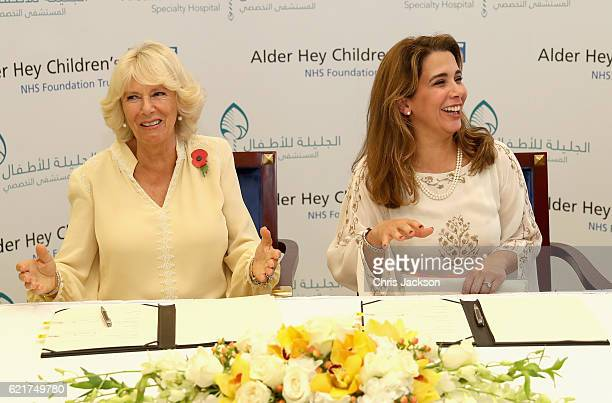 Camilla Duchess of Cornwall and Princess Haya Bint Al Hussein laugh as they sign a commercial agreement between Alder Hey and Al Jalila Children's...