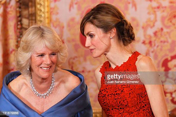 Camilla Duchess of Cornwall and Princess Letizia Princess of Asturias attend an official dinner at the Palacio Real de Madrid on day one of a three...