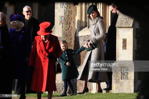 Camilla Duchess of Cornwall and Queen Elizabeth II followed by Catherine Duchess of Cambridge and Princess Charlotte leave after attending the...