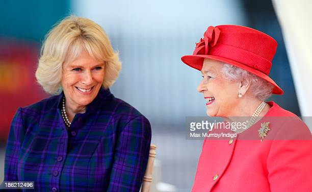 Camilla Duchess of Cornwall and Queen Elizabeth II watch a riding display as they visit the Ebony Horse Club and Community Riding Centre on October...
