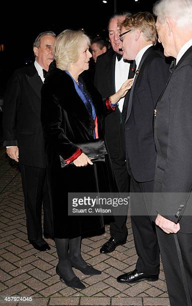 Camilla Duchess of Cornwall and Simon BrooksWard attend The London International Horse show at Olympia Exhibition Centre on December 19 2013 in...
