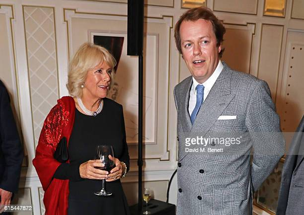 "Camilla, Duchess of Cornwall, and son Tom Parker Bowles attend the launch of ""Fortnum & Mason: The Cook Book"" by Tom Parker Bowles at Fortnum & Mason..."