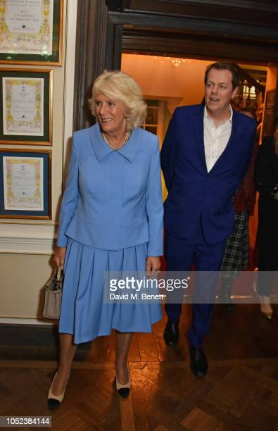 "Camilla, Duchess of Cornwall, and Tom Parker Bowles attend the launch of the ""Fortnum & Mason Christmas & Other Winter Feasts"" cookbook at Fortnum &..."