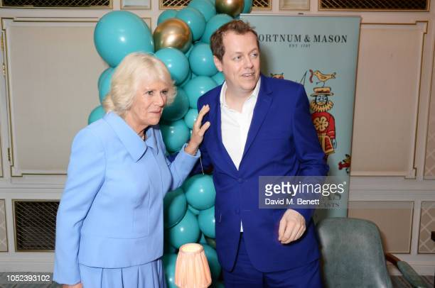 "Camilla, Duchess of Cornwall, and Tom Parker Bowles attend the launch of the ""Fortnum & Mason Christmas & Other Winter Feasts"" cookbook by Tom Parker..."