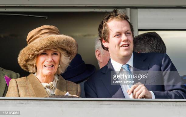Camilla, Duchess of Cornwall and Tom Parker Bowles watch the racing on day 2 of The Cheltenham Festival at Cheltenham Racecourse on March 12, 2014 in...