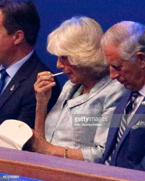 Camilla Duchess of Cornwall applies her lip gloss as she attends the Opening Ceremony for the Glasgow 2014 Commonwealth Games at Celtic Park on July...