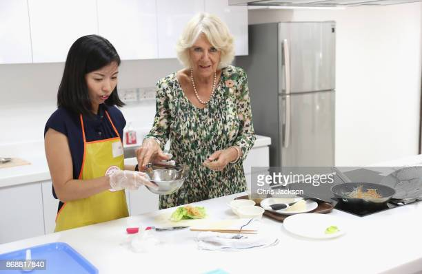 Camilla Duchess of Cornwall attends a cooking demonstration during her visit to the Tiong Bahru Community Centre on November 1 2017 in Singapore...
