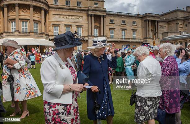 Camilla Duchess of Cornwall attends a Garden Party in honour of the centenary of the Women's Institute held at Buckingham Palace on June 2 2015 in...