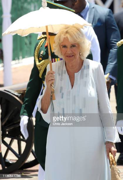 Camilla Duchess of Cornwall attends a parade and wreath laying ceremony at Hereos Square on March 19 2019 in Bridgetown Barbados The Prince of Wales...