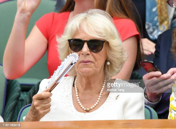Camilla Duchess of Cornwall attends day nine of the Wimbledon Tennis Championships at All England Lawn Tennis and Croquet Club on July 10 2019 in...