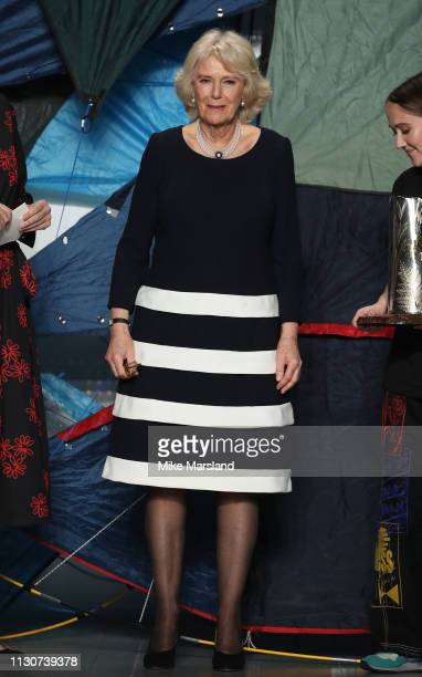 Camilla Duchess of Cornwall attends the Bethany Williams show during London Fashion Week February 2019 at the BFC Show Space on February 19, 2019 in...