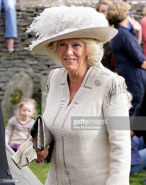 Camilla Duchess of Cornwall attends the wedding of her nephew Ben Elliot and MaryClare Winwood at the church of St Peter and St Paul Northleach on...