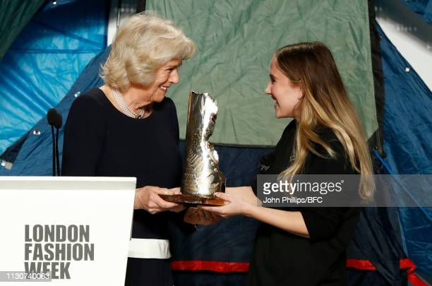 Camilla, Duchess Of Cornwall awards the Queen Elizabeth II award for British Design to designer Bethany Williams at the Bethany Williams show during...