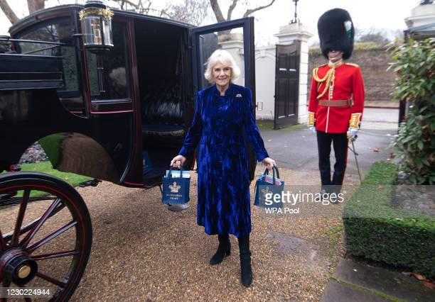 Camilla, Duchess of Cornwall bearing gifts at The Royal Brougham with Captain Charles Ross Assistant Equerry as the Duchess of Cornwall decorates the...