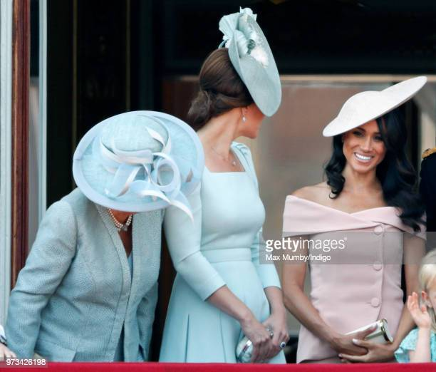 Camilla Duchess of Cornwall Catherine Duchess of Cambridge and Meghan Duchess of Sussex stand on the balcony of Buckingham Palace during Trooping The...