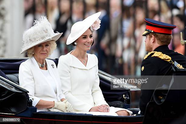 Camilla, Duchess of Cornwall, Catherine, Duchess of Cambridge and Prince Harry sit in a carriage during the Trooping the Colour, this year marking...