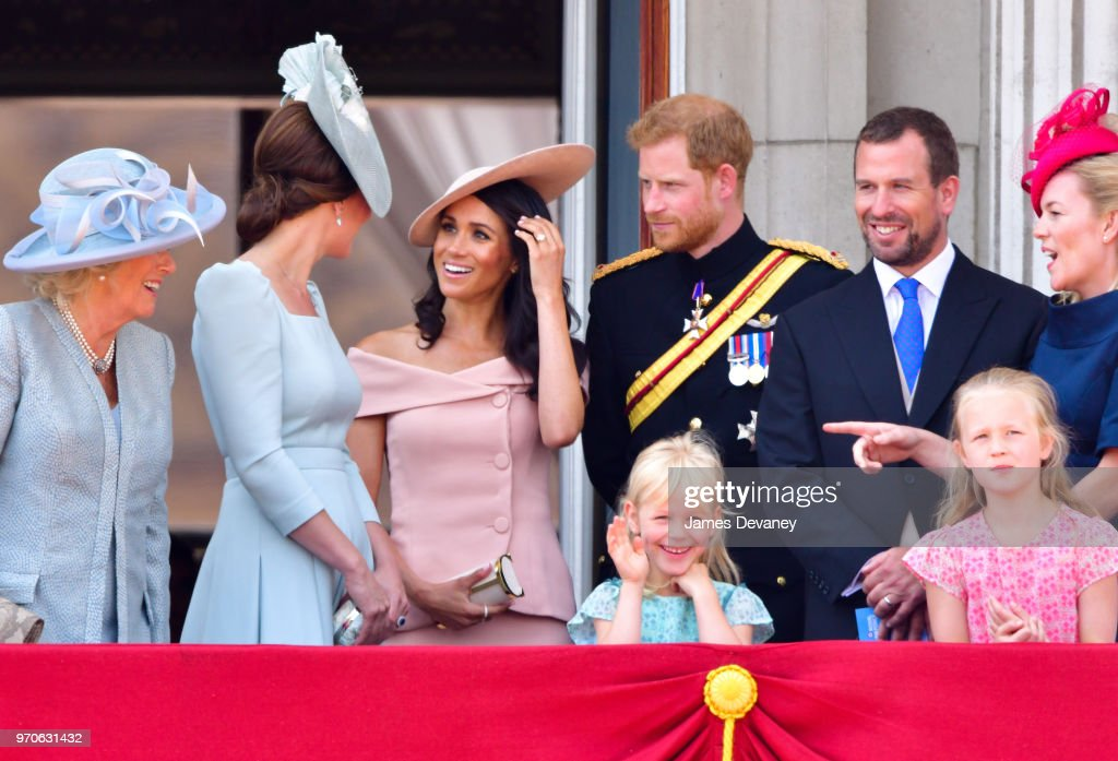 Camilla, Duchess Of Cornwall, Catherine, Duchess of Cambridge, Meghan, Duchess of Sussex, Prince Harry, Duke of Sussex, Peter Phillips, Autumn Phillips, Isla Phillips and Savannah Phillips stand on the balcony of Buckingham Palace during the Trooping the Colour parade on June 9, 2018 in London, England.