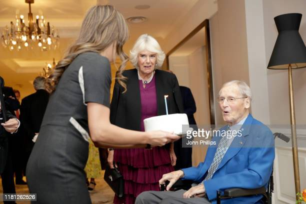 Camilla Duchess of Cornwall celebrates the birthday of Nicholas Parsons as she attends a reception hosted by Gyles Brandreth President of the Oscar...