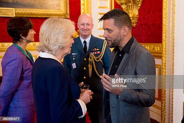 Camilla Duchess of Cornwall chats with Canadian television host for CBC George Stroumboulopoulos during a reception for Canadians living and working...