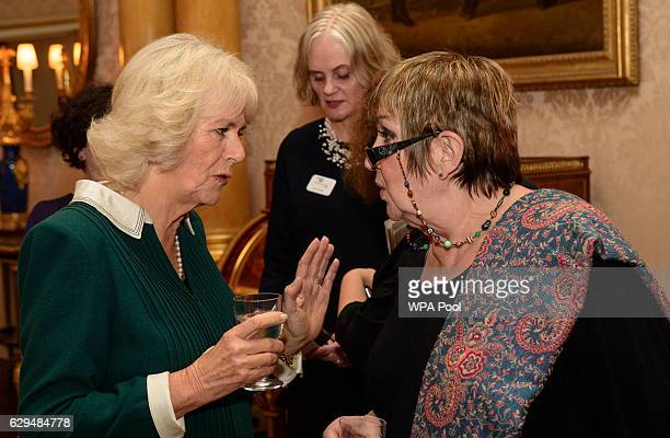 Camilla Duchess of Cornwall chats with presenter Jenni Murray as she attends a reception and recording at Buckingham Palace to mark the announcement...