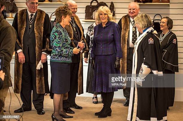 Camilla Duchess of Cornwall chats with some members of the Worshipful Company of Glovers of London at Dents factory on February 24 2015 in Warminster...