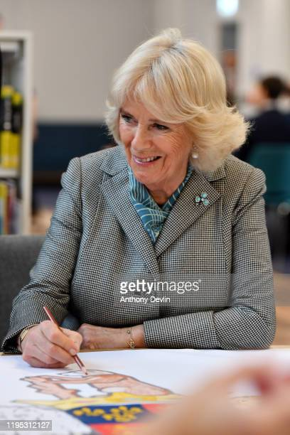 Camilla Duchess of Cornwall colours the final part of a drawing during the official opening of Lichfield Street Hub on January 22 2020 in Walsall...