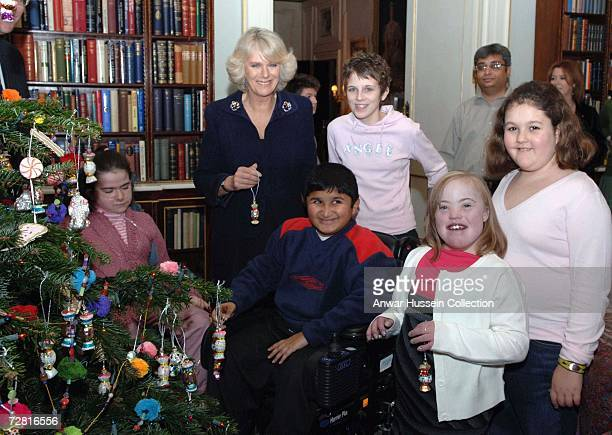 Camilla Duchess of Cornwall decorates the Christmas tree at Clarence House with the help of children from the Shooting Star Children's Hospice on...