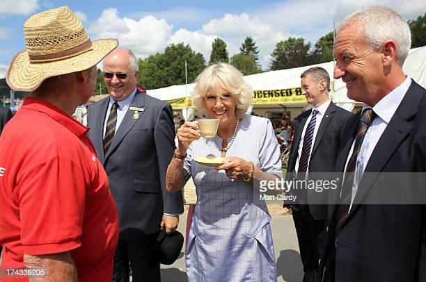 Camilla, Duchess of Cornwall drinks a cup of tea as she visits the Royal Welsh Show at Royal Wales Showground on July 24, 2013 in Builth Wells, Wales.