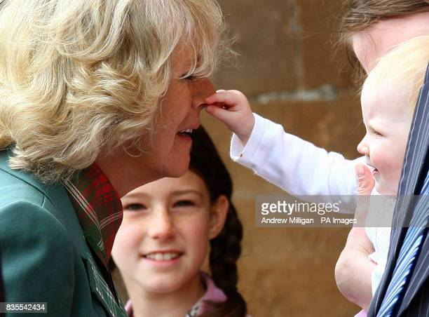 Camilla Duchess of Cornwall, Duchess of Rothesay who has her nose pulled by one year old Katie MacPherson watched by mum Janette from Drumnadrochit...