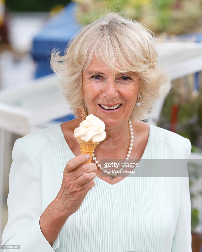 Camilla, Duchess of Cornwall eats an ice cream as she attends The Hampton Court Flower Show at Hampton Court Palace on July 1, 2015 in London, England.