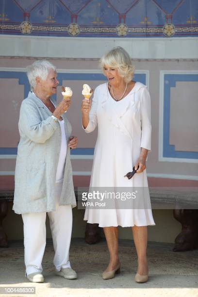 Camilla Duchess of Cornwall enjoys an ice cream with Dame Judi Dench as she arrives at Queen Victoria's private beach next to the monarch's holiday...