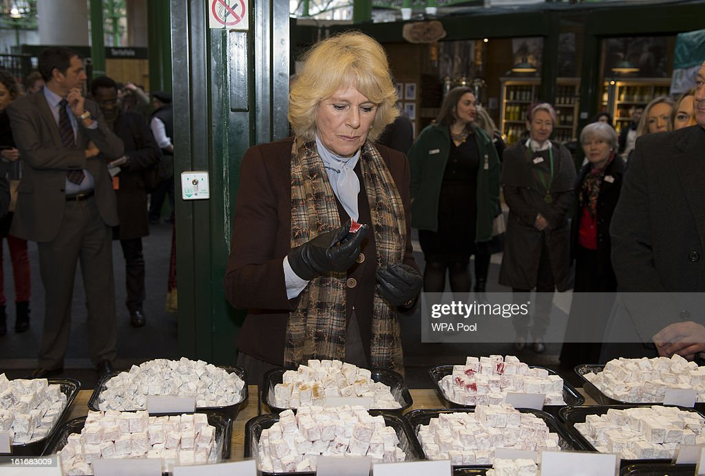 Camilla, Duchess of Cornwall enjoys some turkish delight during a visit to Borough Market on February 13, 2013 in London, England.