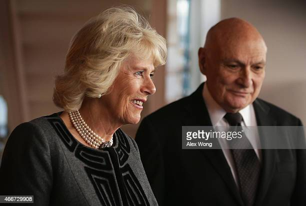 Camilla Duchess of Cornwall escorted by Artistic Director of the Shakespeare Theatre Company Michael Kahn leaves after her visit to the Company March...