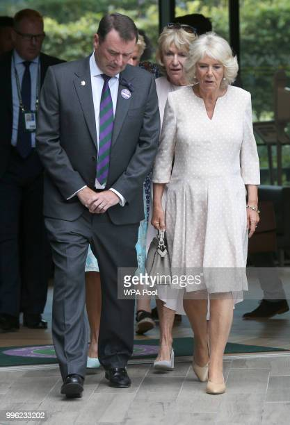 Camilla Duchess of Cornwall meets Sergeant Kelly Griffith as she attends day nine of the Wimbledon Lawn Tennis Championships at All England Lawn...