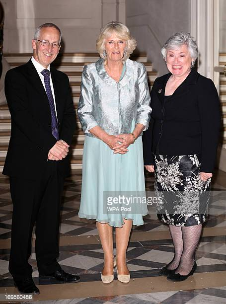 Camilla Duchess of Cornwall greets Ambassador Sir Peter Ricketts and his wife Lady Suzanne Ricketts as she arrives at a reception at the British...