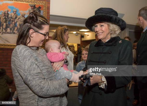 Camilla Duchess of Cornwall greets Army wife Casey Brook and daughter Affiah as she visits the 4th Battalion The Rifles at Normandy Barracks on...