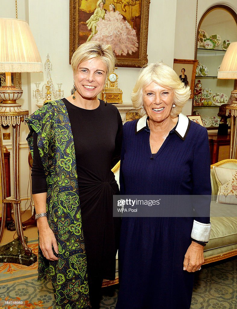 Camilla, Duchess of Cornwall greets Princess Laurentien of the Netherlands (L) at a private meeting in Clarence House on October 16, 2013 in London, England.