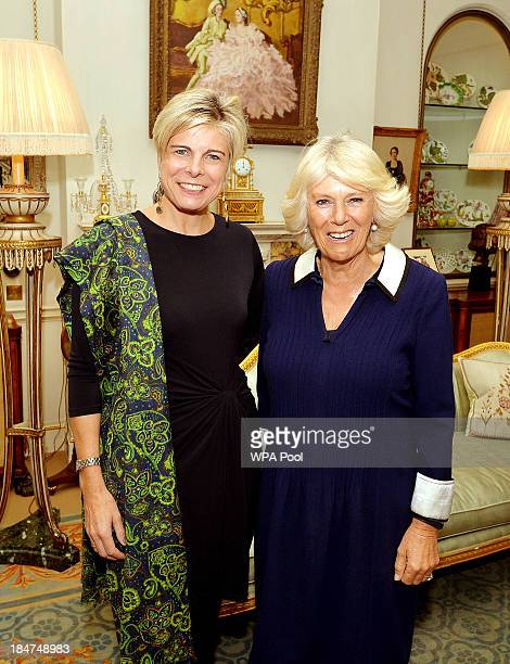 Camilla, Duchess of Cornwall greets Princess Laurentien of the Netherlands at a private meeting in Clarence House on October 16, 2013 in London,...