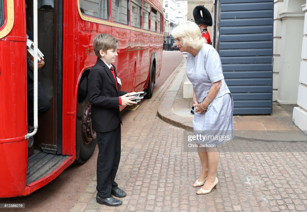 Camilla, Duchess of Cornwall greets school children from Hemlington Hall Academy in Middlesbrough and Berkeley Primary School in Hounslow as they disembark a bus ahead of a tea party hosted by the Duchess of Cornwall to celebrate the Duchess's Bookshelves Project at Clarence House on July 11, 2017 in London, England. The Project is an initiative to find the nation's 70 favourite children's books to mark the Duchess of Cornwall's 70th birthday.