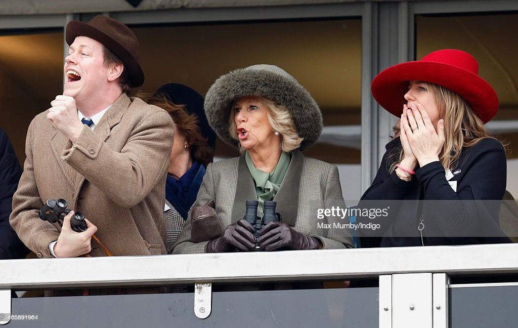 Camilla, Duchess of Cornwall (centre) her son Tom Parker Bowles (left) and daughter Laura Lopes (right) watch the racing as they attend day 2 of the Cheltenham Festival at Cheltenham Racecourse on March 11, 2015 in Cheltenham, England.