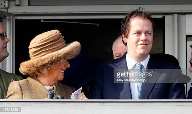 Camilla Duchess of Cornwall holds a wad of money after she and son Tom Parker Bowles watch the first race as they attend Ladies Day day 2 of the...
