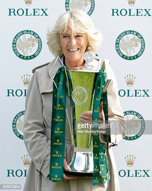 Camilla Duchess of Cornwall holds the Rolex Grand Slam of Eventing Trophy before presenting it to Michael Jung after he won the Badminton Horse...