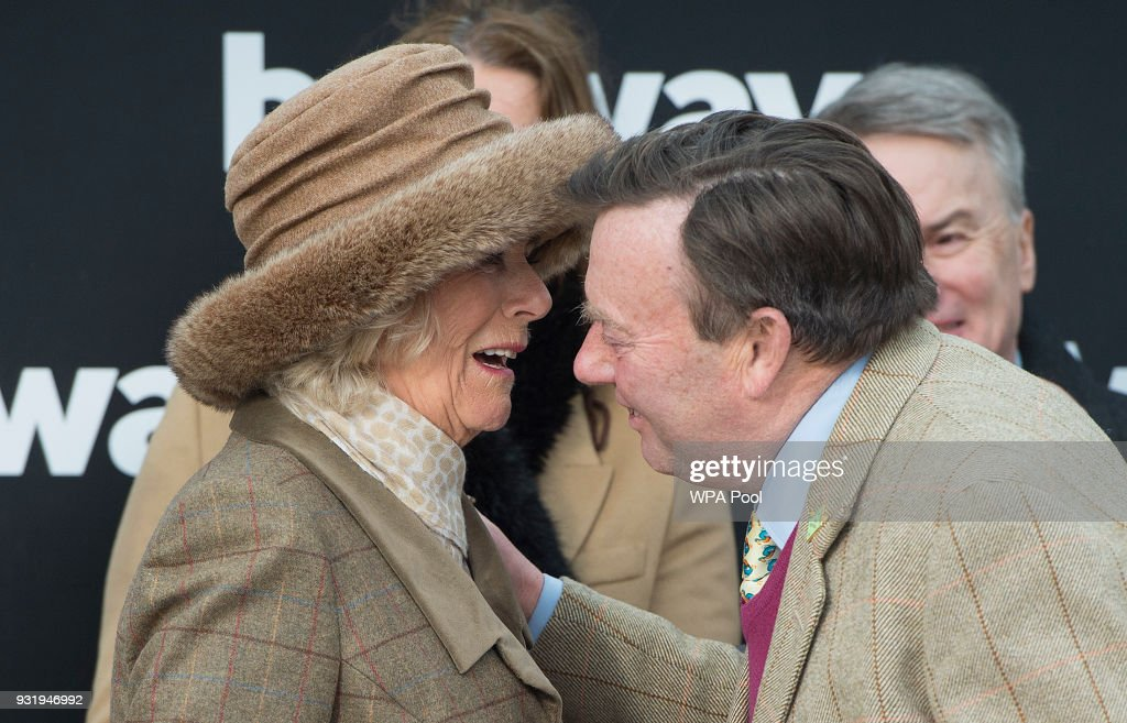 Camilla, Duchess of Cornwall Honorary Member of the Jockey Club, makes a presentation to the winner of The Betway Queen Mother Champion Steeple Chase, Winning Jockey Nico De Boinville on 'Altior', Winning Owner Patricia Pugh and Winning Trainer Nicky Henderson (pictured) as she attends the second day of The Festival, Ladies Day at Cheltenham Racecourse on March 14, 2018 in Cheltenham, England. The Duchess