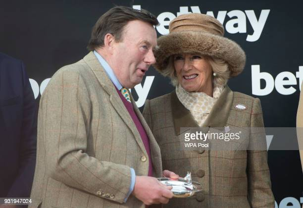 Camilla Duchess of Cornwall Honorary Member of the Jockey Club makes a presentation to the winner of The Betway Queen Mother Champion Steeple Chase...